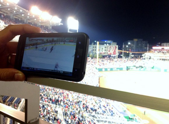 Watching hockey at baseball game
